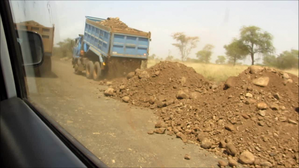 Construction of roads to the sugar plantations from a DFID/USAID vehicle